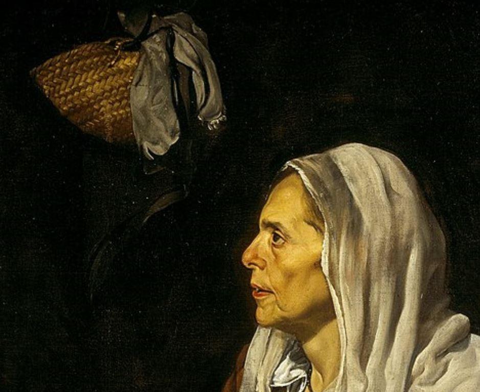 Old woman frying eggs basket