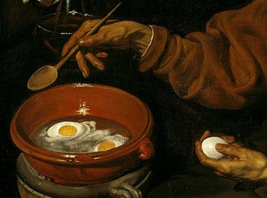 Old woman frying eggs detail of the ggs