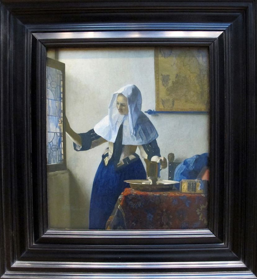 Woman with a water jug by Johannes Vermeer