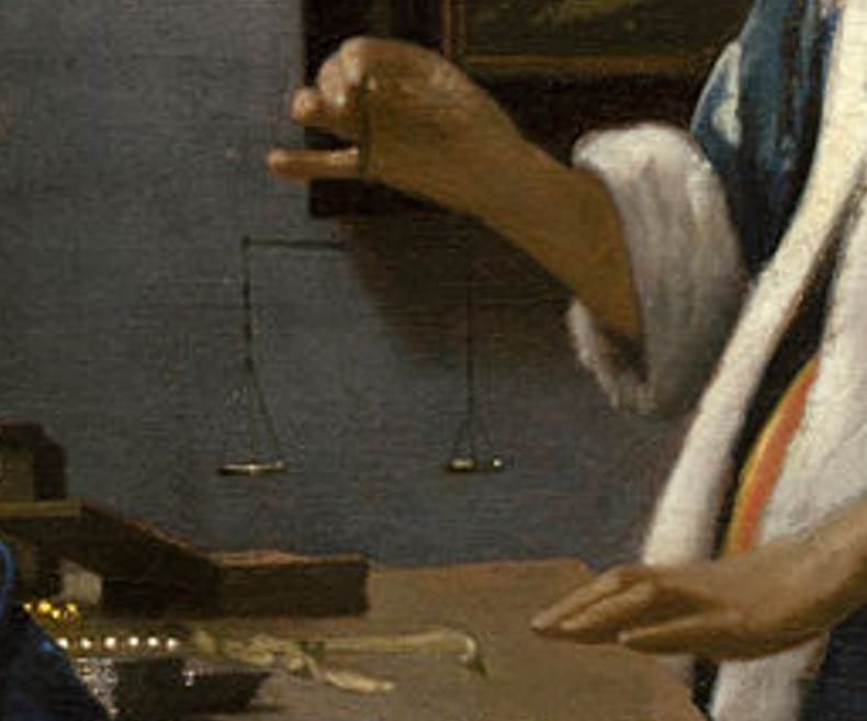 WOman holding a balance detail of the balance